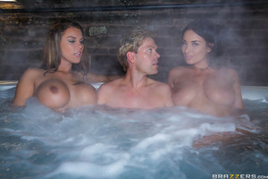 After a long day of shooting an epic series, Peta and Anissa are ready to relax in the hot tub. Ryan joins his co-stars and things heat up fast. Peta and Anissa want a piece of his cock, so the trio moves indoors for a big boobied threesome!