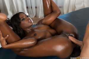 There's nothing sexier than to have Ana Foxxx's seductive curves getting drenched in oil before rubbing herself all over your body. This ebony babe can't wait to slide her luscious body all over a big, hard cock before slipping that dick inside her drippi